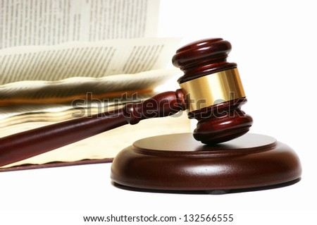 Referee hammer and an open book - stock photo