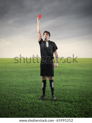 Referee showing a red card - stock photo