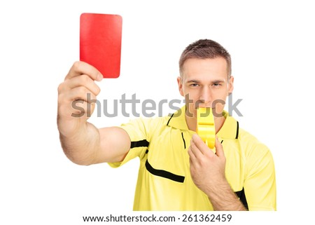 Referee showing red card and blowing huge whistle isolated on white background - stock photo