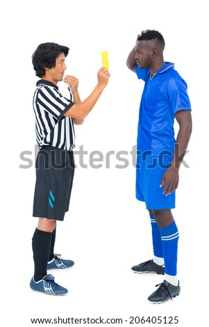 Referee showing yellow card to football player on white background - stock photo