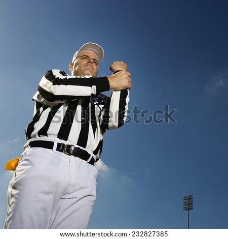 Referee Signaling Penalty - stock photo