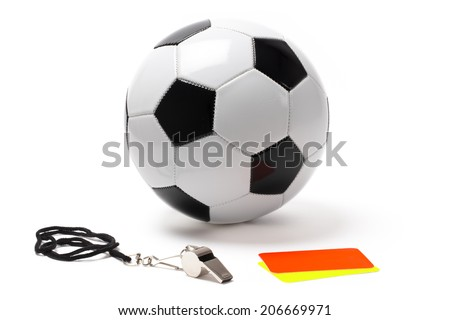 Referee whistle, red and yellow card and ball.   - stock photo