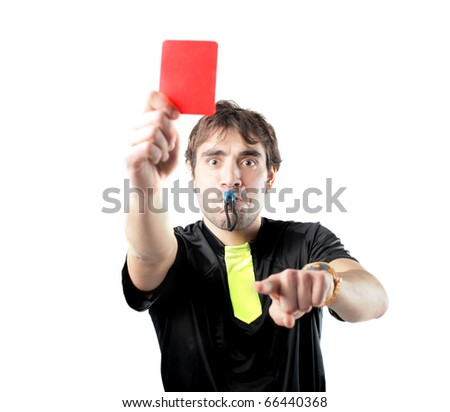 Referee whistling and showing a red card - stock photo