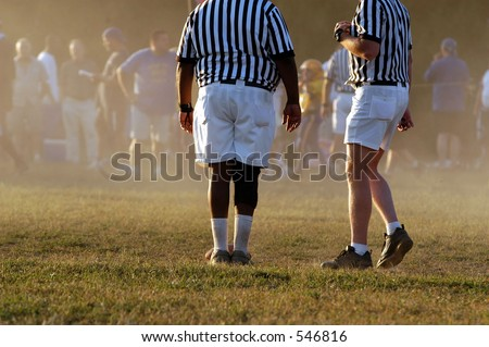 Referees on top of the action - stock photo