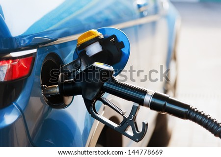 Refill and filling Oil Gas Fuel at station - stock photo