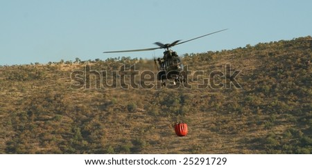 Refilling for bush fire fight - stock photo