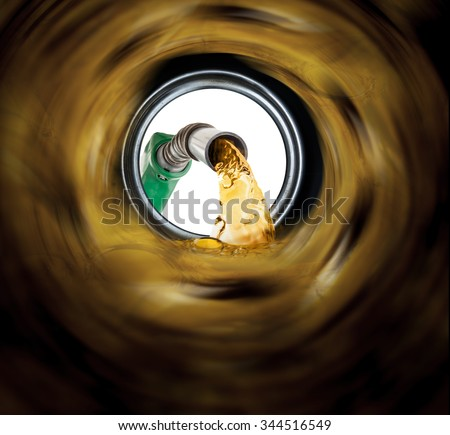 Refilling fuel view from inside of gas tank of a car - stock photo