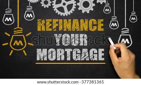 refinance your mortgage on blackboard - stock photo