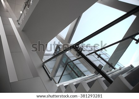 Refined photo of staircase in modern style with all-over glazing. Substantial digital modification / substitution of notable architectural features with other ones made this image unrecognizable. - stock photo