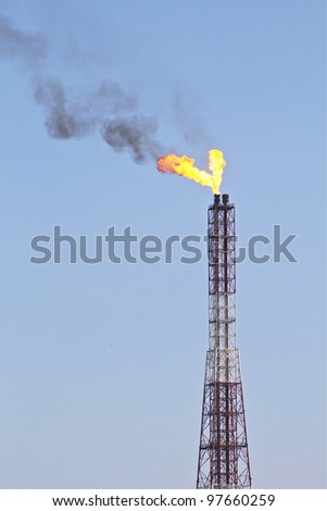 Refinery flame - stock photo