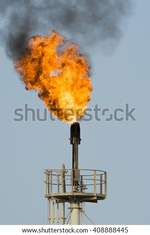 Refinery flare - flaring  of dangerous gases in oilfield . - stock photo