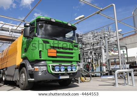 refinery fuel station with large waiting oil-truck - stock photo