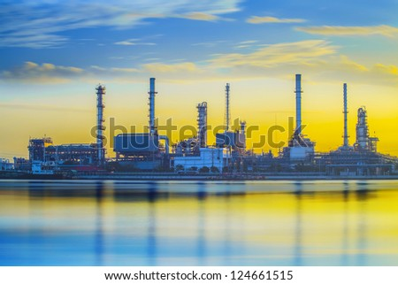 Refinery industrial plant with river and sunset - stock photo