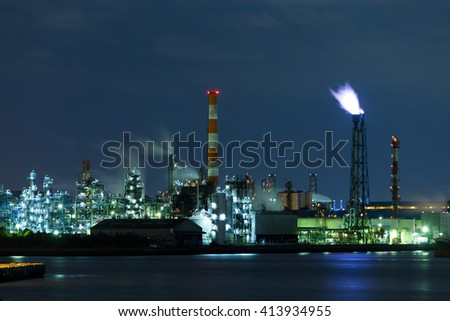 Refinery petrochemical factory at night - stock photo
