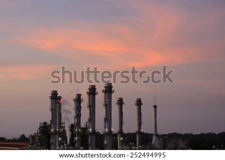 Refinery reflected light water sunset industry in thailand .