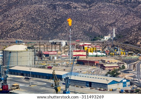 refinery with the chimney causing fire - stock photo