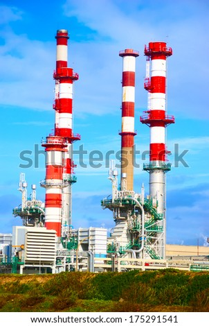 refining factory pipe against the sky - stock photo