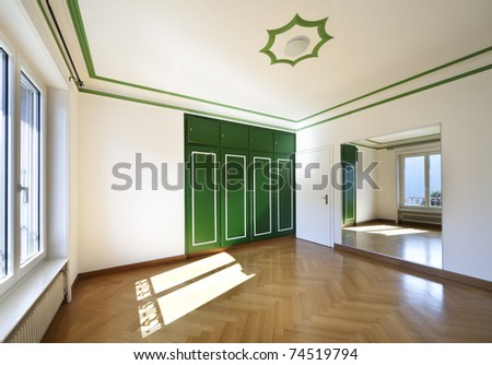 refitted lovely apartment, empty room with mirror - stock photo