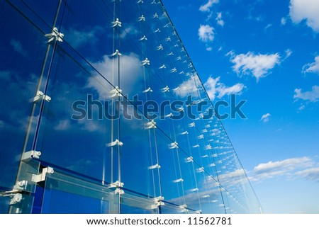 reflected clouds on modern office - stock photo