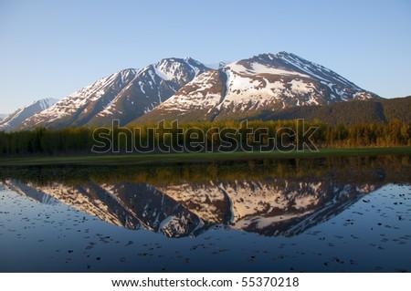 Reflected view of Paradise Peak in Alaska - stock photo