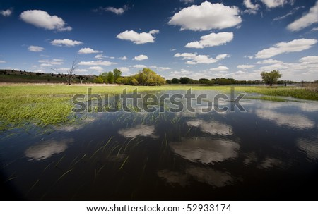 Reflecting Clouds in flooded South Dakota's James River Valley - stock photo