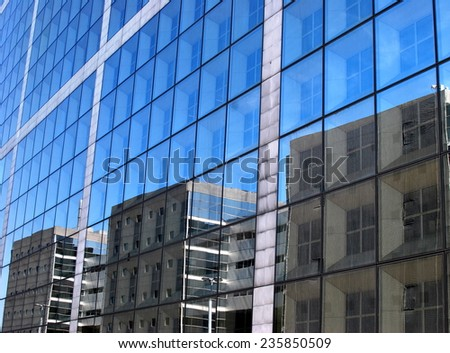 Reflecting facades - stock photo