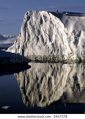 Reflecting ice wall - stock photo