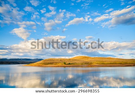 Reflecting Lake with Clouds at Curecanti National Recreation Area - stock photo