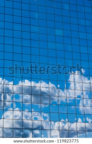 reflecting sky in glass of office building abstract background - stock photo