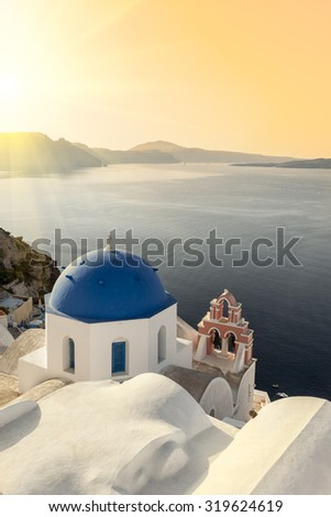 Reflecting sun on a blue dome in Oia, Santorini