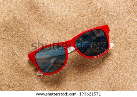 Reflecting sunglasses on the beach  - stock photo