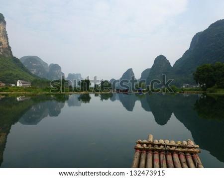 Reflection, bamboo rafting down Li River, Yangshuo, China - stock photo