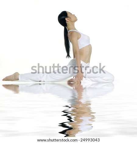 Reflection for beautiful young woman practicing yoga - stock photo