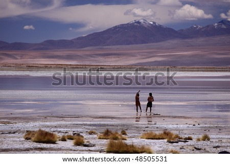 Reflection from a lagoon in Bolivia - stock photo