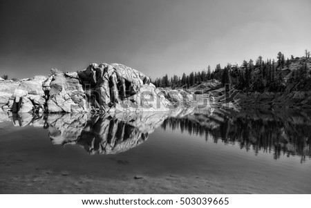 Reflection from a rock cliff in Lake Mary above Brighton ski resort in the Wasatch mountains Utah USA.