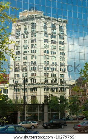 Reflection in a mirror building in Grand Rapids - stock photo