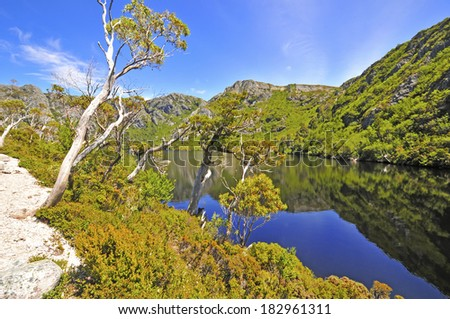 Reflection in Calm Lake, Cradle Mountain National Park, Tasmania, Australia - stock photo