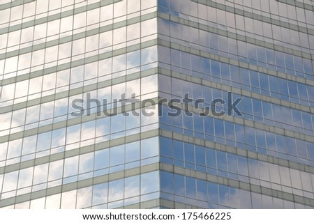 Reflection in glass facade of the building  - stock photo