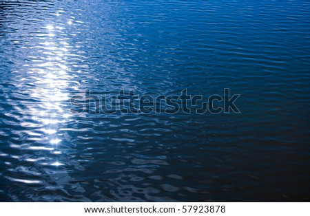Reflection in sea water surface - stock photo