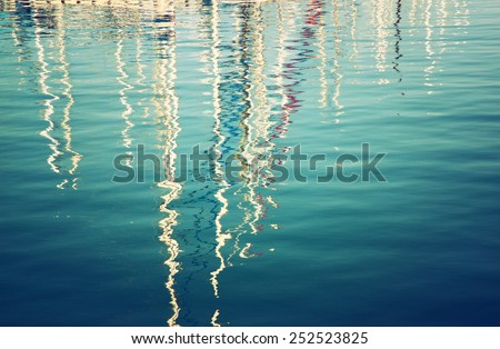 reflection in water boats. vintage filtered image  - stock photo
