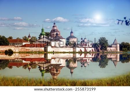 Reflection lake walls and towers Kirillo-Belozersky Monastery - stock photo