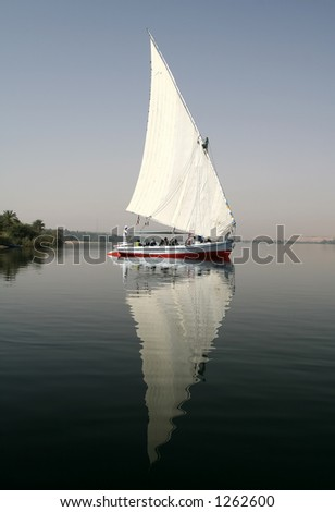 Reflection of a felucca at Nile River, Egypt - stock photo