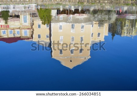 reflection of a medieval castle in the river - stock photo