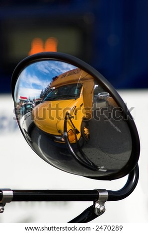 Reflection of a school bus sitting in traffic