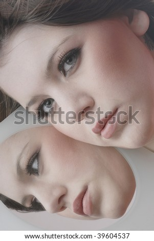 Reflection of a young woman
