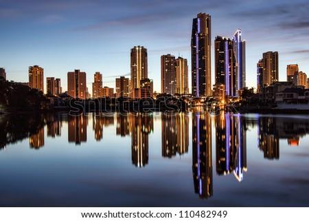 Reflection of apartments at sunrise, Gold Coast Australia - stock photo