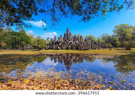 Reflection of Bayon temple in Angkor Thom, one of landmark in Siem Reap, Cambodia - stock photo