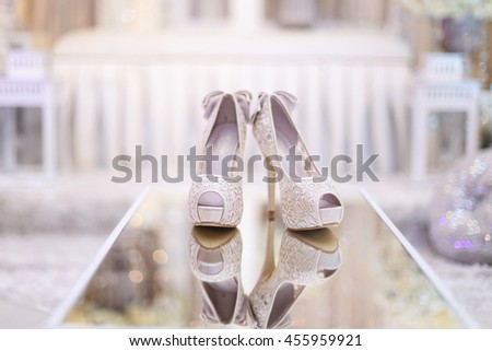 Reflection of Beautiful Bride's high heel shoes. - stock photo