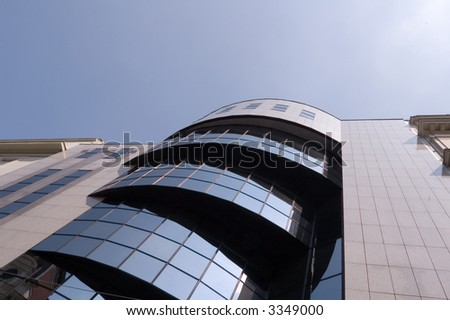 Reflection of blue sky at Building architecture