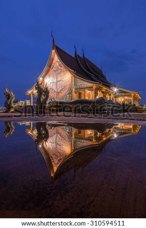 Reflection of Buddha temple after rain the temple will reflect with the water like a mirror - stock photo